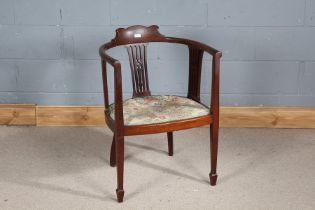 Edwardian mahogany tub chair, having shaped back rail, pierced slat backs and floral upholstery,