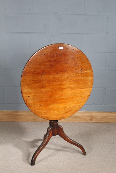 19th century mahogany tilt top occasional table, the circular top above a knopped column and