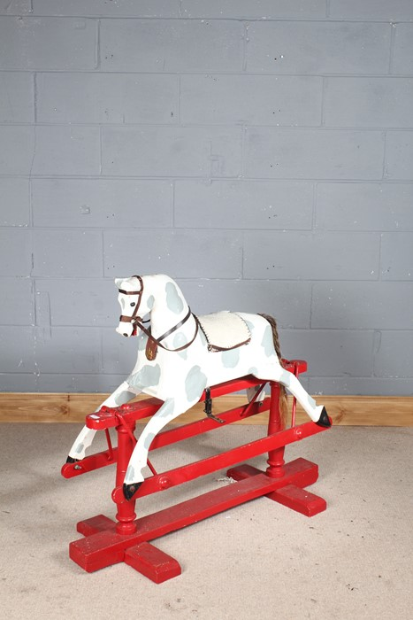 Early 20th century wooden rocking horse, later painted in white and grey on a red base, 110cm long