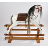 Lines Brothers Ltd. rocking horse, the white painted body with black and white mane and tail,