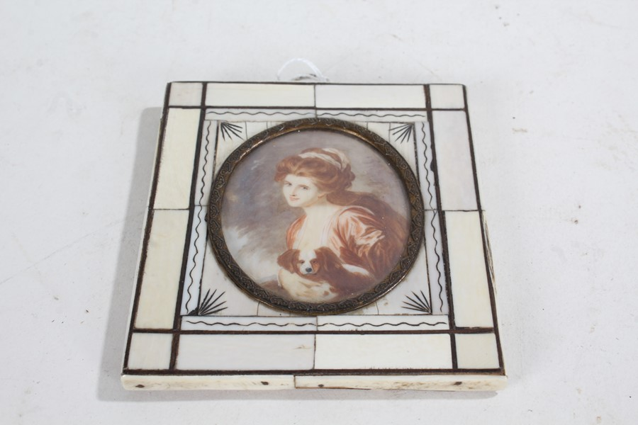 19th Century hand painted miniature portrait, depicting a lady with red hair holding a dog, the