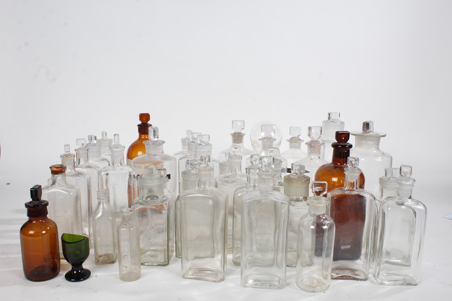 Collection of various glass apothecary bottles, and a Victorian eye glass (qty)