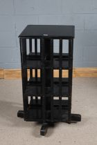Late Victorian ebonised revolving bookcase, with slatted sides and raised on stand, 48cm x 96.5cm
