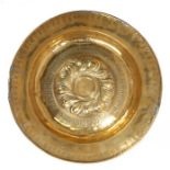 Early 17th Century brass Nuremberg Alms dish, with gadrooned boss flanked by a band of