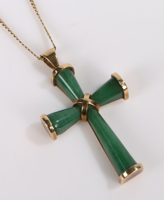 Green stone cross, the cross mounted with an X tot he centre and yellow metal ends attached to a 9