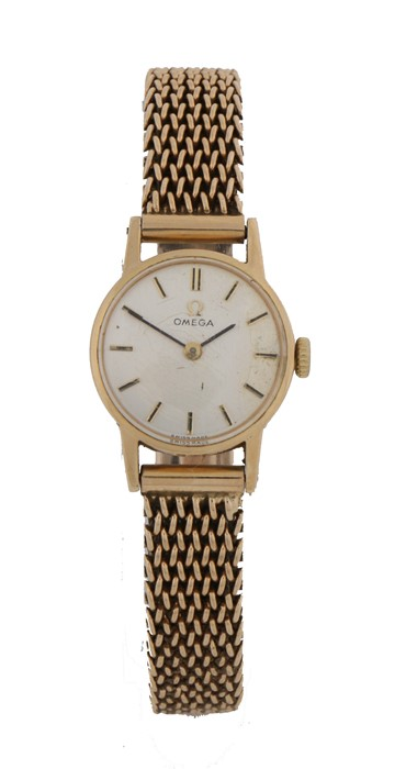 Omega 9 carat gold ladies wristwatch, the signed silver dial with baton markers, manual wound, the