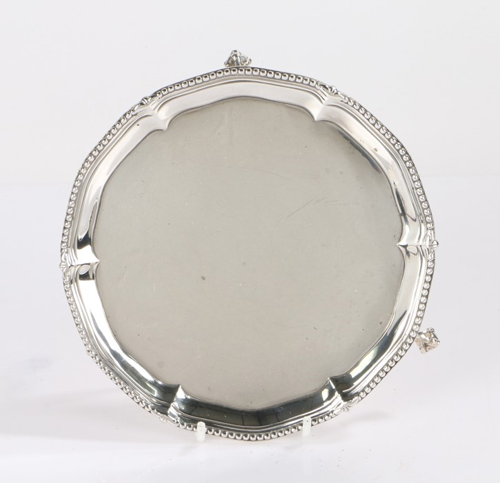 George III silver card tray, London 1775, maker I.C, with beaded gadrooned border, raised on three