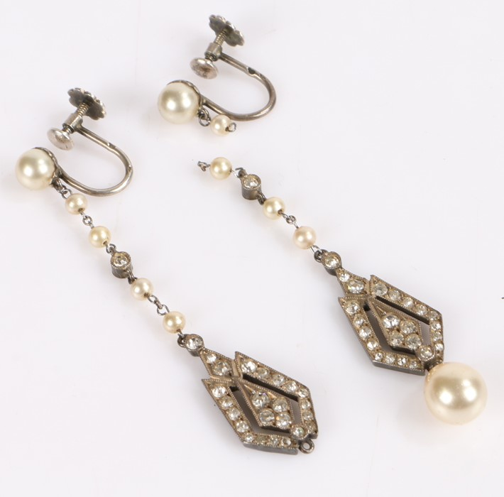 Art Deco style pair of silver pendant earrings, with long pearl set chain and Art Deco drops set