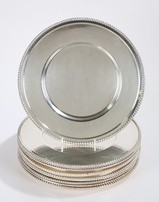 Set of twelve 20th Century silver plated dishes, with beaded borders and dished centres, crossed