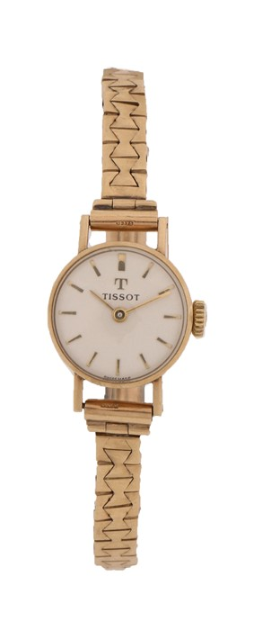 Tissot 9 carat gold cased ladies wristwatch, the signed white dial with baton markers, manual wound,