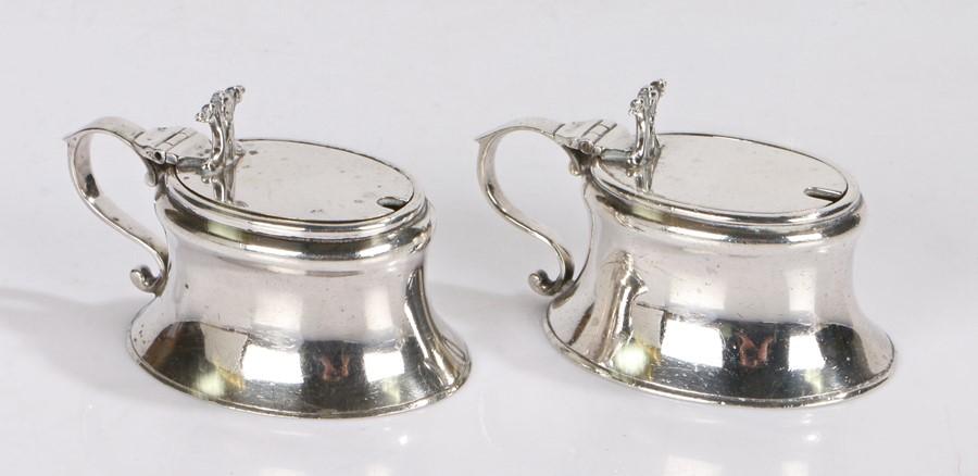 Pair of Edward VIII Britannia standard silver mustard pots, London 1929 and 1931, maker Vander &