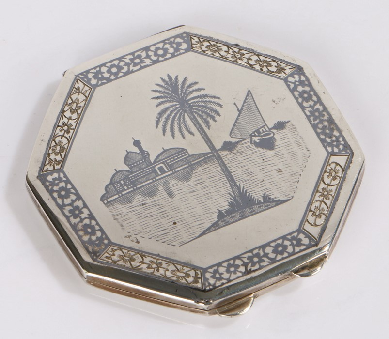 Egyptian white metal and niello decorated powder compact, of octagonal form, the cover with