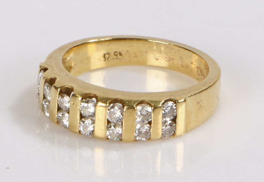 18 carat gold diamond set ring, with a dual row of round cut diamonds containing a total of fourteen
