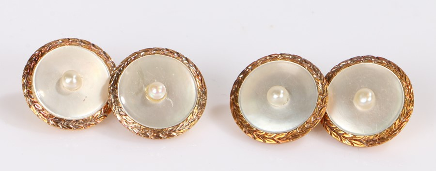 Pair of 18 carat gold cufflinks, set with a central pearl and mother of pearl back on 18 carat gold,