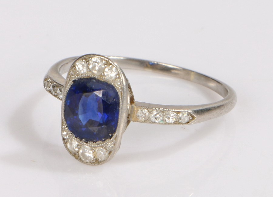 Art Deco sapphire and diamond set ring, the central oval sapphire with a diamond surround, further