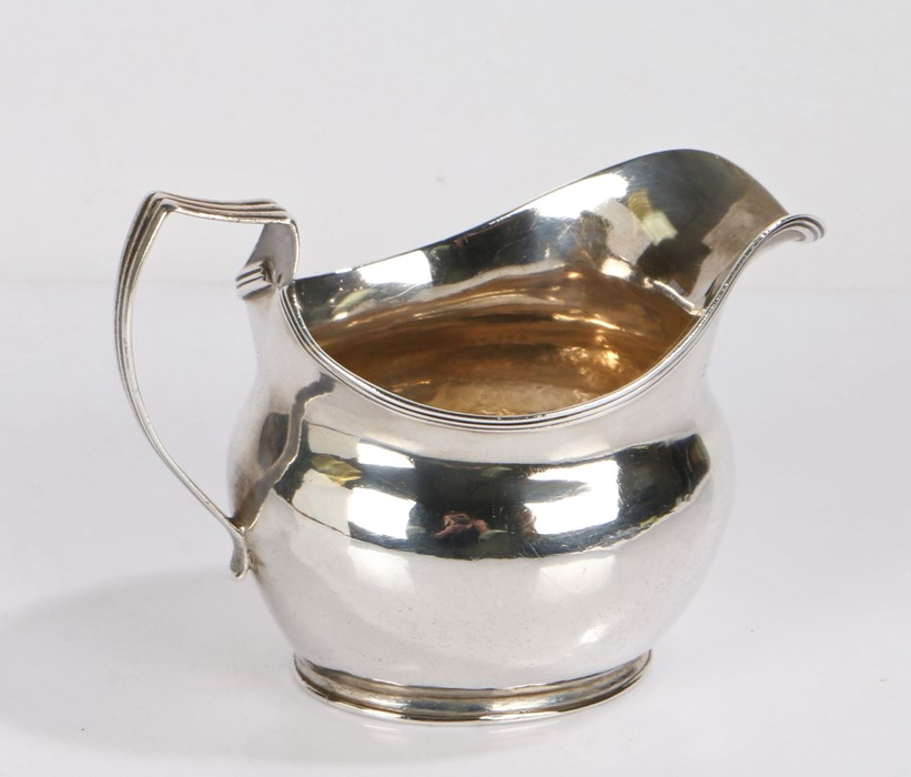 George III silver cream jug, London 1813, makers mark rubbed, with angular reeded handle and bulbous