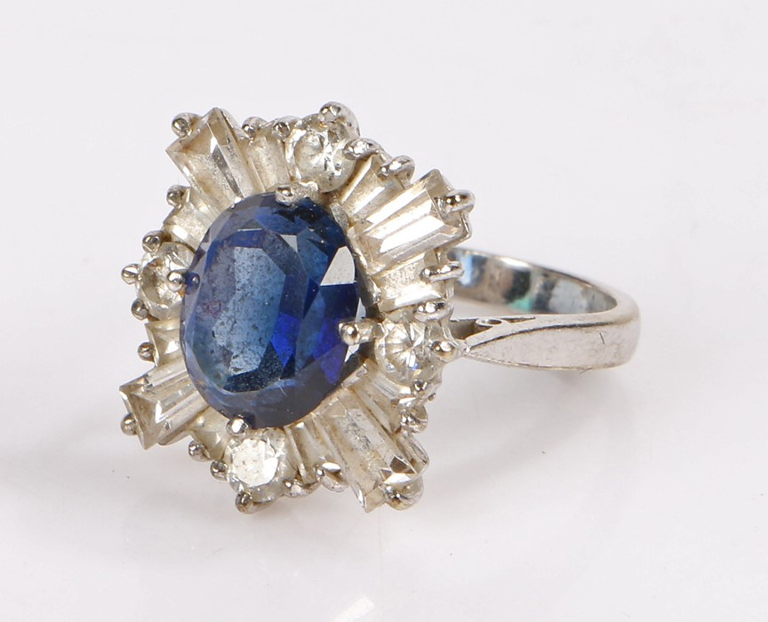 9 carat white gold ring, set with a faux sapphire and paste diamond effect surround, ring size K