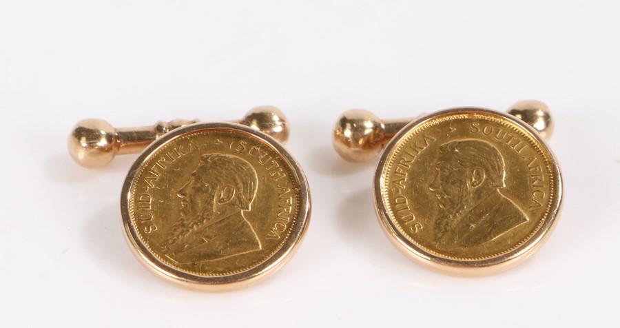 Pair of 9 carat gold cufflinks, each set with a 1/10 Krugerrand, 13.9g