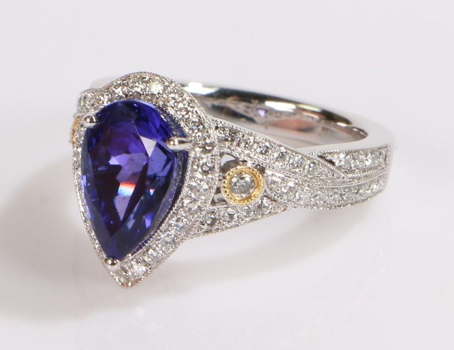 18 carat white gold tanzanite and diamond set ring, the central pear cut tanzanite at 3.54 carats