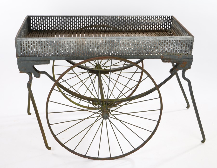 19th Century bier, with a later tray attached to the coffin carrying base on two wheels, 109cm long