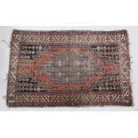 Moslaghan rug, the stepped tomato red field with blue coloured medallion within typical indigo