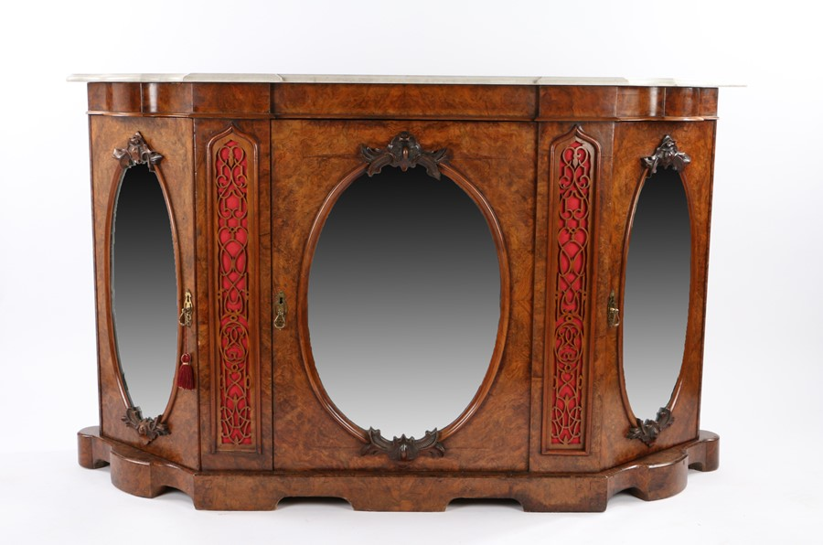 19th Century walnut credenza, the marble top above the mirrored central door flanked by fret