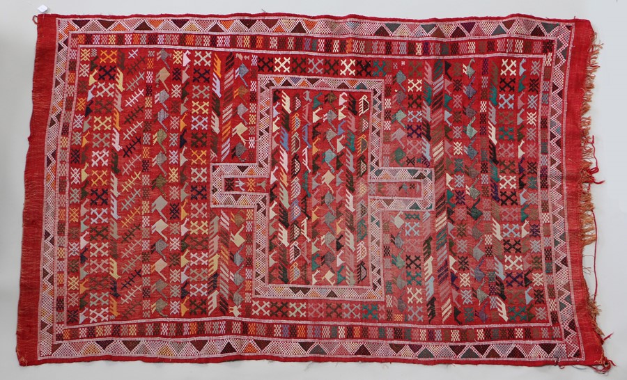 Red Gebben Kilim modern Persian rug, the red ground with stylised animal decoration, 220cm x 140cm