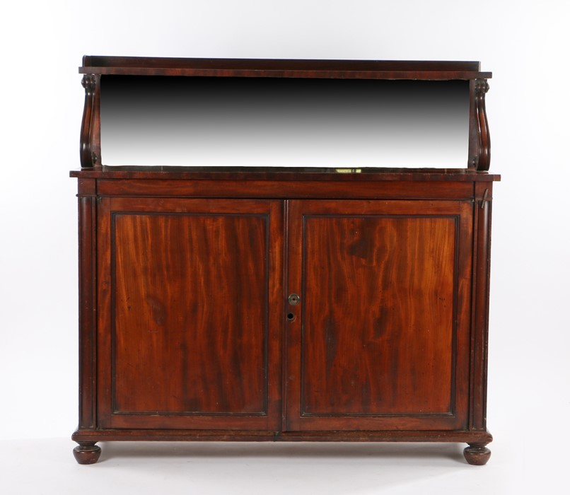 William IV mahogany chiffonier, the shelved gallery top above a mirror back and scroll arms above