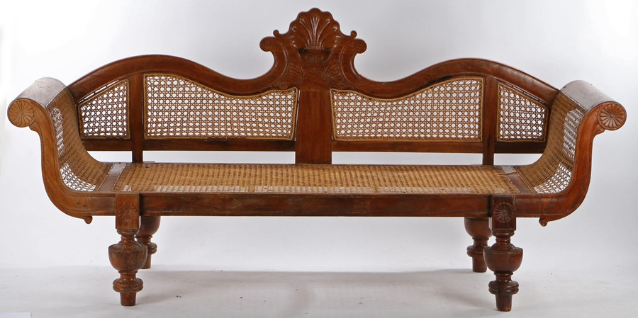 19th Century padouk wood settee/day bed, the arched caned sides flanking the caned seat raised on