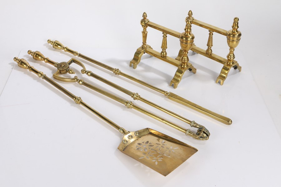 Set of three fire irons, with urn finials above reeded stems, together with a pair of brass
