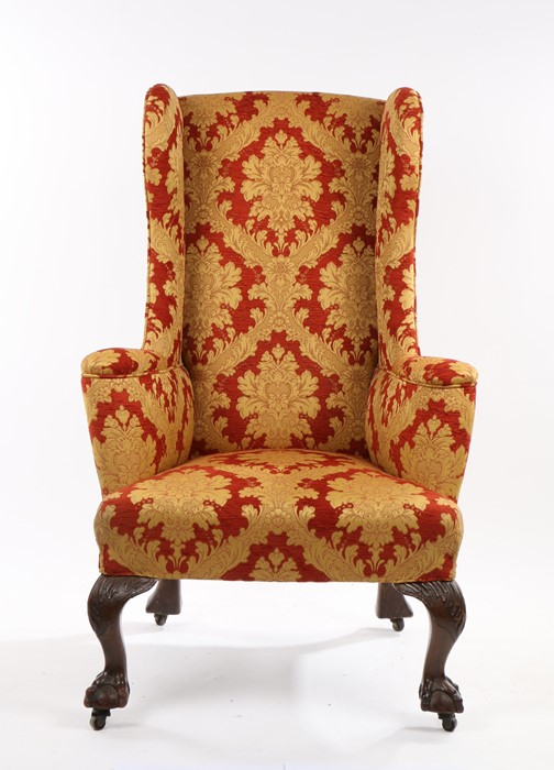 George III style wingback armchair, early 20th Century, the high back above a stuff over seat and