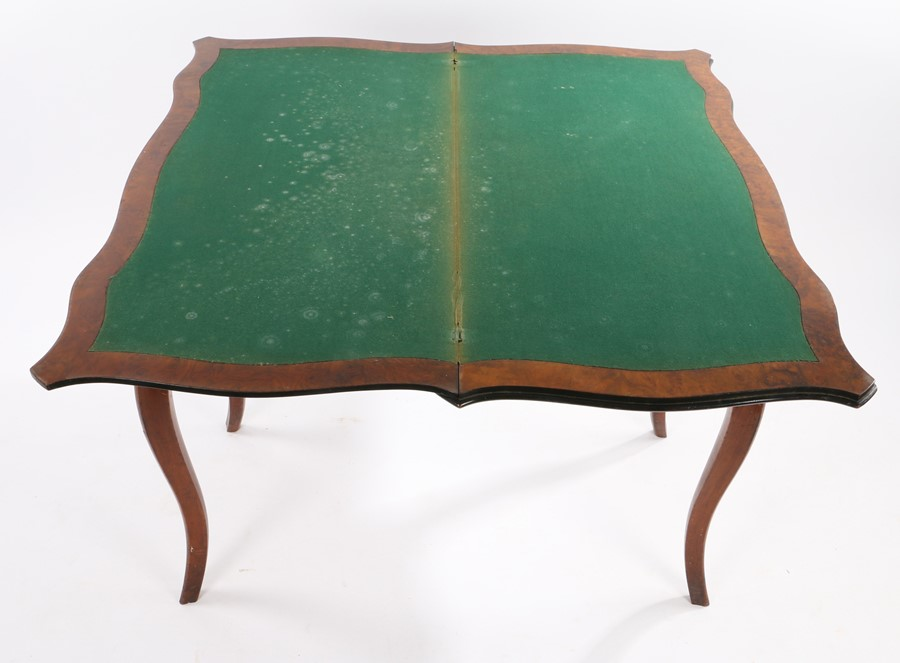 Victorian walnut games table, the all round serpentine fold over top above slender curved legs, 99cm - Image 3 of 3