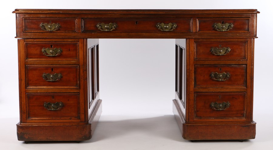 Victorian mahogany kneehole desk, the rectangular top with inset leather above nine drawers to the