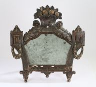 18th Century carved and painted and parcel gilt easel mirror, having a shaped mirror plate in a
