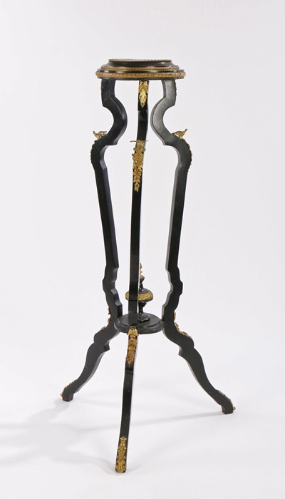 French Empire style jardinière stand, the circular top above arched legs surmounted by gilt metal