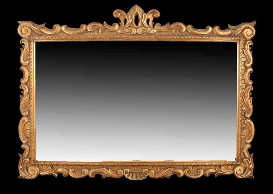 19th Century giltwood wall mirror, the later rectangular plate housed within the shell and C