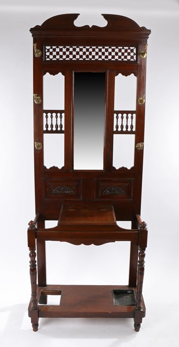 Edwardian mahogany hall stand, the arched top above fret panel and six hooks either side of a