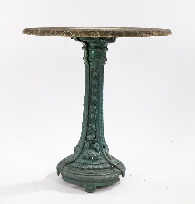 19th Century cast iron table, the associated circular maple top above the painted base with trailing
