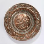 20th Century embossed copper charger, decorated to its centre with three entwined fish, framed by