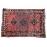 Old Persian Shiraz carpet, the red ground with triple lozenge pattern centre, 270cm x 164cm