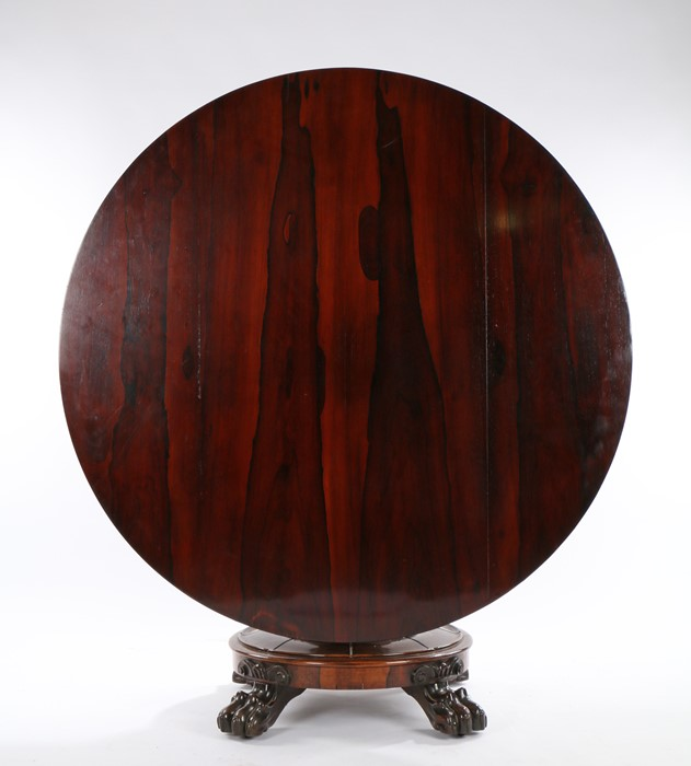 William IV rosewood breakfast table, the circular tilt top raised on a gadrooned tapering stem,