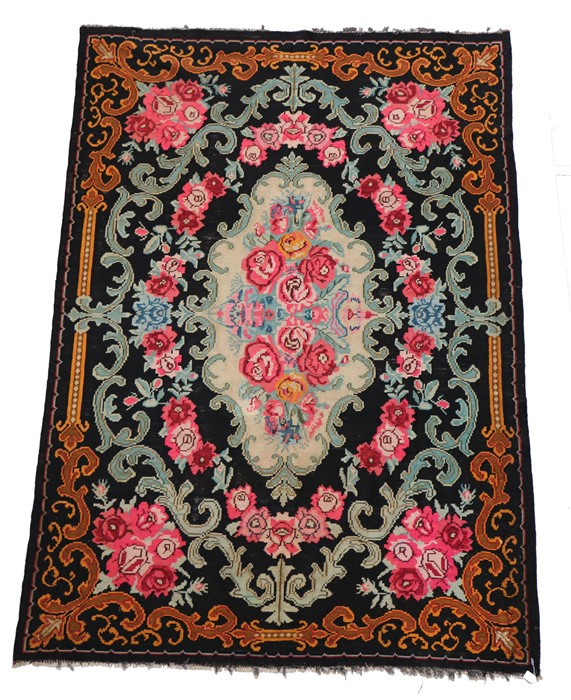 Modern Persian Bijar Kilim rug, the black ground with foliate and scroll decoration, 300cm x 210cm