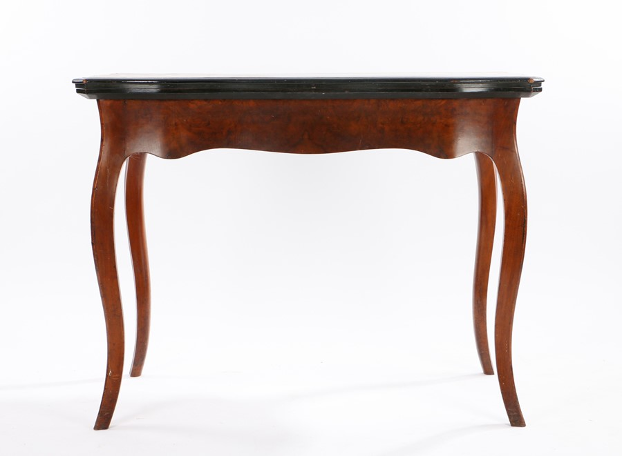 Victorian walnut games table, the all round serpentine fold over top above slender curved legs, 99cm