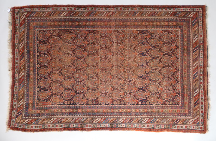 Old Persian Shirvan carpet, the red ground with multiple borders and tasselled ends,226cm x 152cm