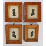 Collection of four 19th Century silhouettes, to include a gilt heightened gentleman, another, a lady