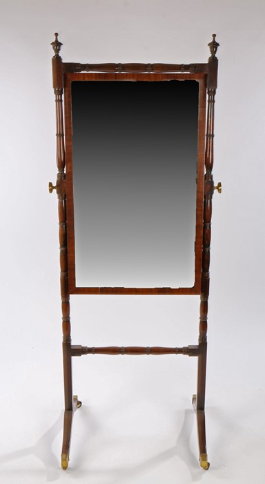 19th Century mahogany cheval mirror within a ring turned frame, the swing mirror held by ring turned