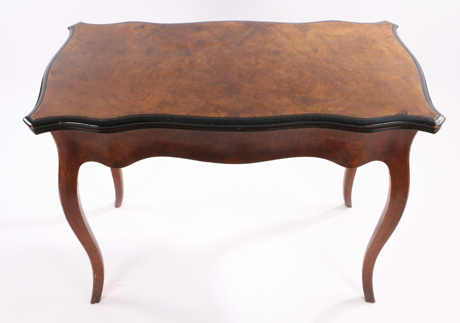 Victorian walnut games table, the all round serpentine fold over top above slender curved legs, 99cm - Image 2 of 3