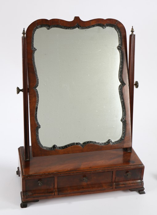 George III mahogany toilet mirror, the mirror plate within an undulating gesso frame held between