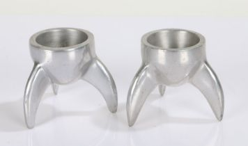 Pair of Art Deco style cast aluminium novelty egg cups, in the form of rocket fins, each 6cm high (