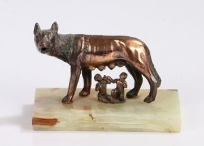 Romulus and Remus, bronzed figure group modelled suckling from a wolf, raised on an onyx rectangular